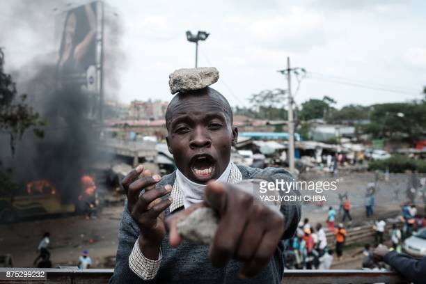 TOPSHOT A supporters of Kenyan's opposition party National Super Alliance reacts during a demonstration following the arrival of opposition leader...
