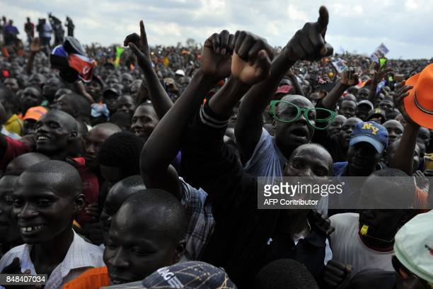 Supporters of Kenya's main political opposition National Super Alliance presidential flagbearer Raila Odinga react during a political rally on...