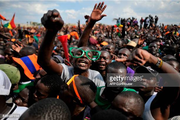 TOPSHOT Supporters of Kenya's main political opposition National Super Alliance presidential flagbearer Raila Odinga react during a political rally...
