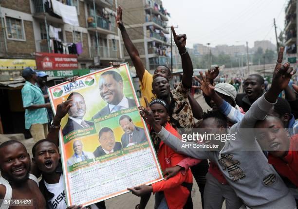 Supporters of Kenya's opposition National Super Alliance celebrate in the streets of the Nairobi slum Mathare on September 1 2017 Kenya's Supreme...