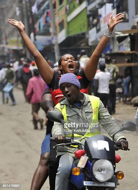 Supporters of Kenya's opposition National Super Alliance leader Raila Odinga celebrate in the streets of Mathare slum in Nairobi on Sepetember 1 2017...