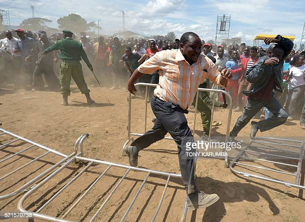 TOPSHOT Supporters of Kenya's President and deputy president overrun a security barricade to get closer to the podium during an interreligious event...