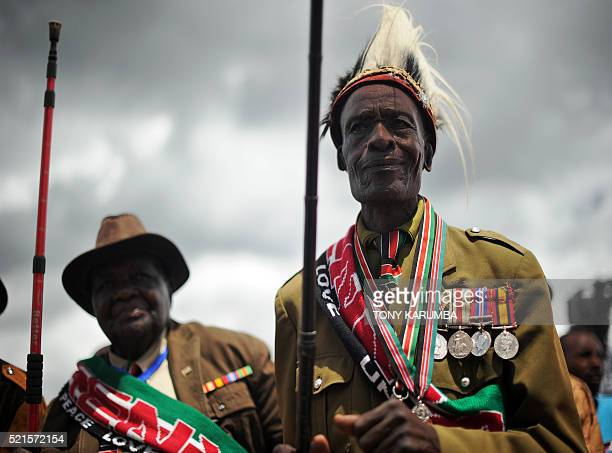 Supporters of Kenya's President Uhuru Kenyatta and his Deputy William Ruto wearing a military uniforms decorated with medals attend an interreligious...