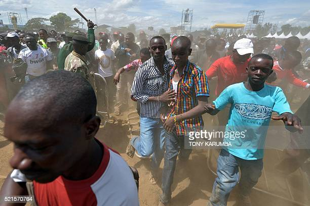 Supporters of Kenya's President Uhuru Kenyatta and of his deputy William Ruto overrun a security barricade to get closer to the podium during an...
