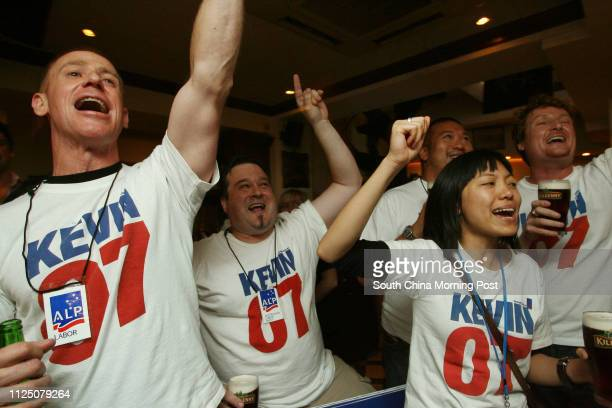 Supporters of Kevin Rudd Michael Wade, Steve Kerr, Xi Liu and Alan Leung winning the Australian Election in McSorley's pub, Central. 24 NOVEMBER 2007