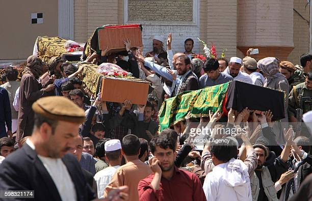 Supporters of King Habibullah Kalakani carry coffins during a funeral ceremony in Kabul Afghanistan on September 01 2016 Vice President Abdul Rashid...