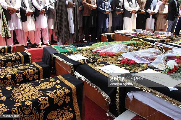 Supporters of King Habibullah Kalakani pray during a funeral ceremony in Kabul Afghanistan on September 01 2016 Vice President Abdul Rashid Dostum's...
