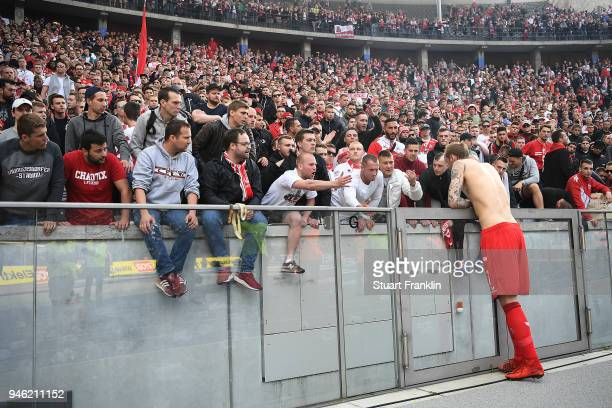 Supporters of Koelen show their feelings about their team while Marcel Risse of Koeln talks to them after the Bundesliga match between Hertha BSC and...