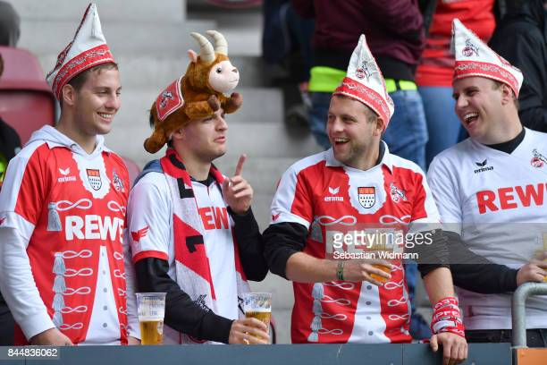 Supporters of Koeln laugh before the Bundesliga match between FC Augsburg and 1 FC Koeln at WWKArena on September 9 2017 in Augsburg Germany