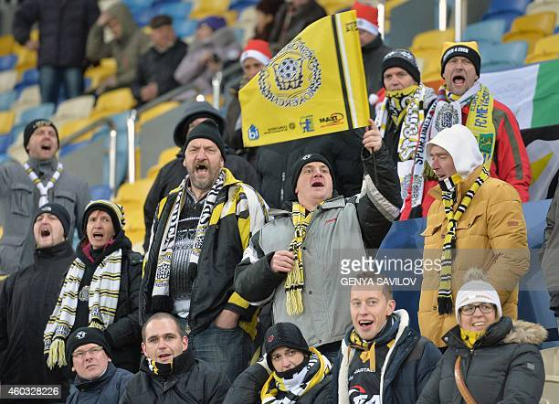 Supporters of KSC Lokeren react during the UEFA Europa League Group L football match between FC Metalist Kharkiv and KSC Lokeren at the Lviv Arena in...