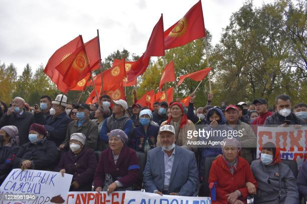Supporters of Kyrgyzstan's ex-president Almazbek Atambayev, holding banners and flags gather during a rally organized against the President of...