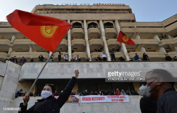 Supporters of Kyrgyzstan's Prime Minister Sadyr Japarov attend a rally near Ala-Archa residence in Bishkek on October 15, 2020. - Kyrgyzstan's...