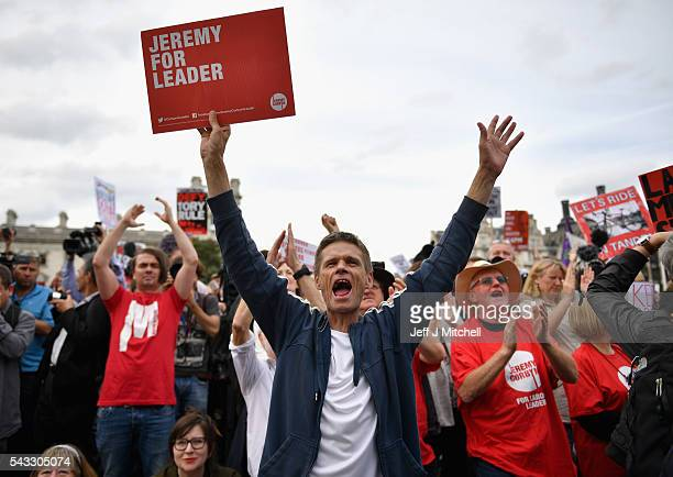 Supporters of Labour leader Jeremy Corbyn hold up signs and shout during Momentum's 'Keep Corbyn' rally outside the Houses of Parliament on June 27...