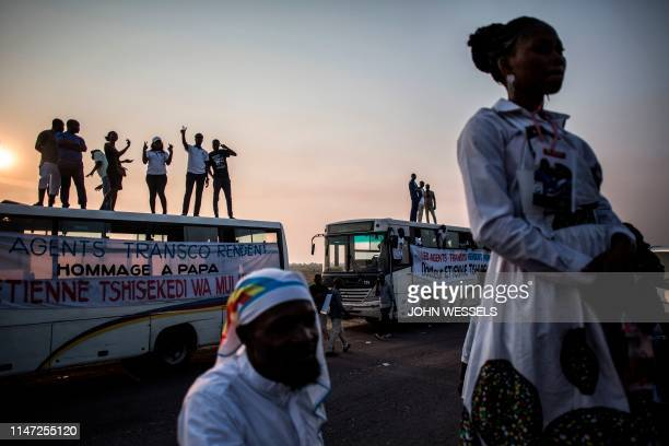 Supporters of late former DR Congo Prime Minister and opposition leader Etienne Tshisekedi, are seen along the road as they wait for his remains to...