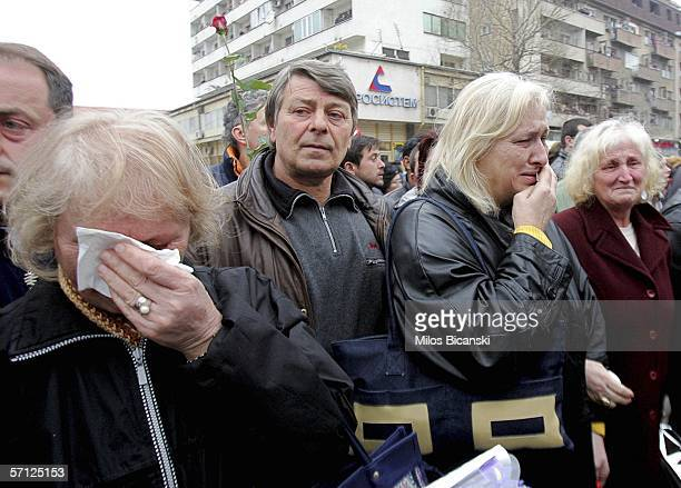 POZAREVAC SERBIA MONTENEGRO MARCH 18 Supporters of late former Yugoslav President Slobodan Milosevic mourn their idol as they line the route of the...