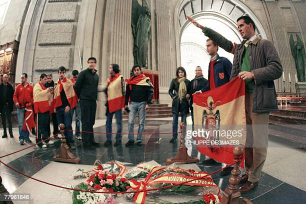 Supporters of late Spanish dictator Francisco Franco congregate 17 November 2007 by his gravestone in the basilica of Santa Cruz at the Valley of the...