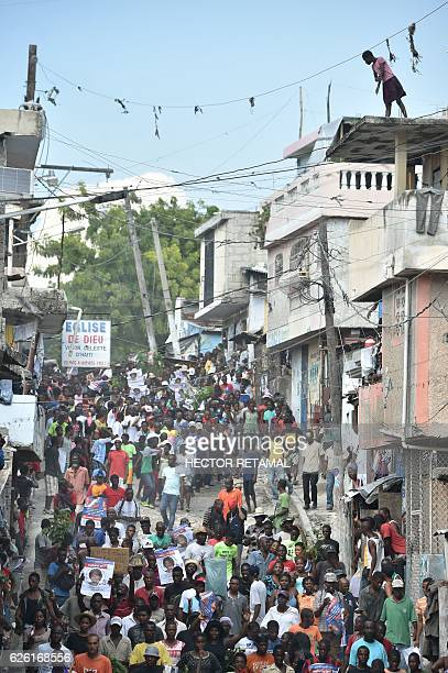 Supporters of Lavalas presidential candidate Maryse Narcisse march to claim the victory of their candidate in PortauPrince on November 27 2016 The...