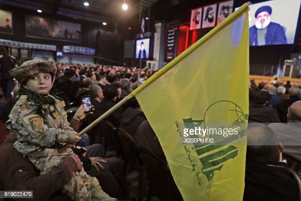 Supporters of Lebanese Hezbollah Leader gather as he delivers a televised speech during a ceremony held by the Shiite party in the capital Beirut...