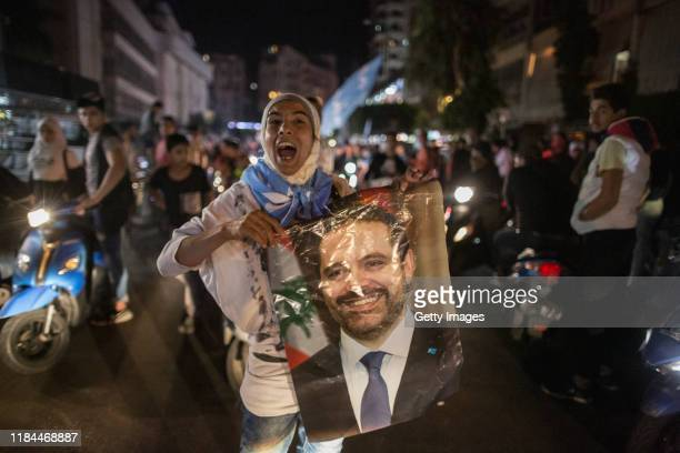 Supporters of Lebanese Prime Minister Saad al Hariri gather to show support on October 30 2019 in Tariq Al Jadideh Beirut Lebanon After 14 days of...
