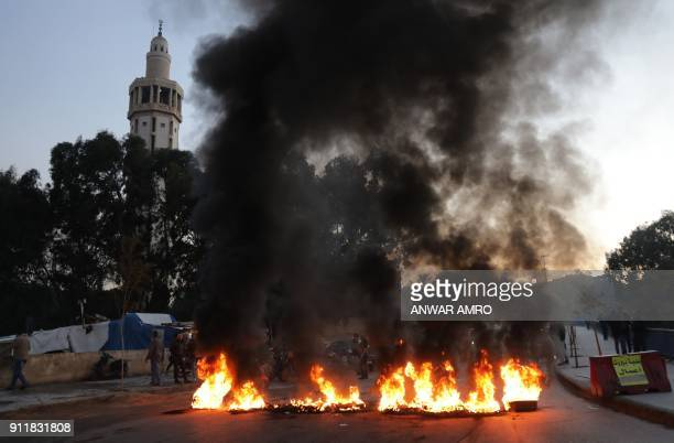 Supporters of Lebanon's Shiite Muslim parliament speaker burn tyres as they block a main road in Beirut on January 29 following a row over a leaked...