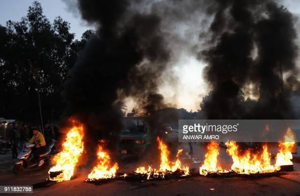 Supporters of Lebanon's Shiite Muslim parliament speaker burn tyres to block a main road in Beirut on January 29 following a row over a leaked video...