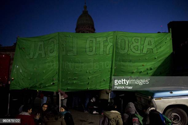 Supporters of legal abortion display a banner in front of the National Congress demanding the sanction of the law of legal free and safe abortion on...