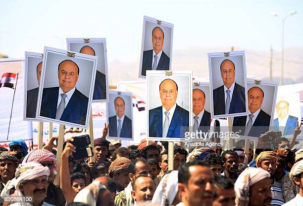 MA'RIB YEMEN NOVEMBER 03 Supporters of Legal Government hold the portraits of Yemeni President Abd Rabbuh Mansur Hadi during a protest against the...