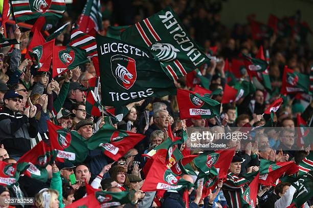 Supporters of Leicester fly the flags during the European Rugby Champions Cup SemiFinal match between Leicester Tigers and Racing 92 at the City...
