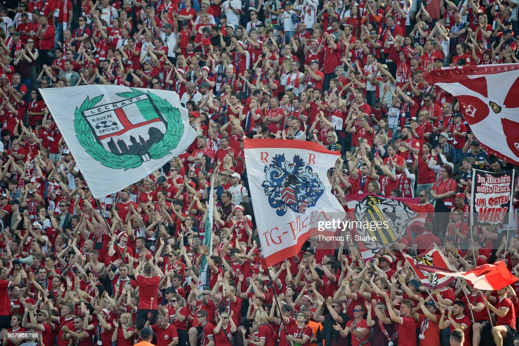 Supporters of Leipzig cheer their team during the Bundesliga match between Hertha BSC and RB Leipzig at Olympiastadion on May 12, 2018 in Berlin, Germany.