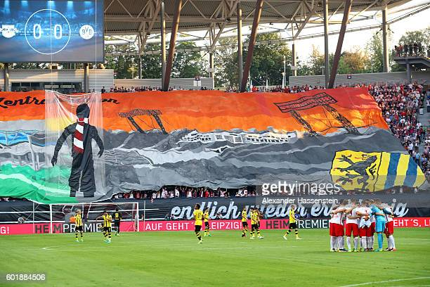 Supporters of Leipzig create a choreography prior to the Bundesliga match between RB Leipzig and Borussia Dortmund at Red Bull Arena on September 10...