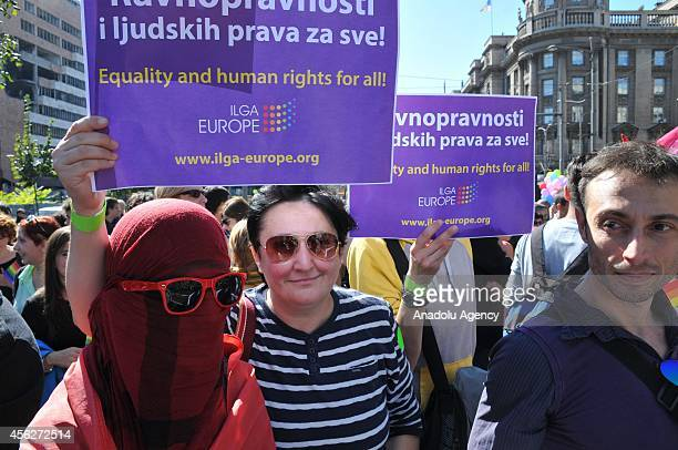 Supporters of lesbian, gay, bisexual, and transgender hold placards during the Gay Pride March held in Belgrade, capital city of Serbia, on September...