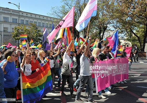 Supporters of lesbian gay bisexual and transgender wave rainbow flags during the Gay Pride March held in Belgrade capital city of Serbia on September...