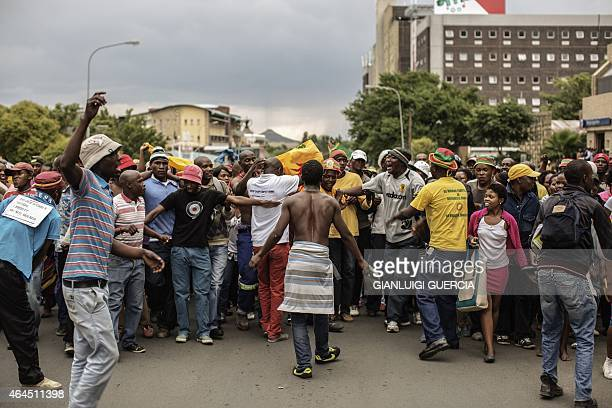 Supporters of Lesotho Prime minister and leader of the All Basotho Convention cheer through the streets of Maseru during a general assembly elections...