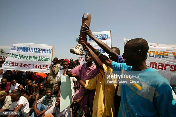 Supporters of Liberian President Charles Taylor demonstrate during the arrival of Nigerian President Olusegun Obassandjo in Liberia Obassandjo flew...