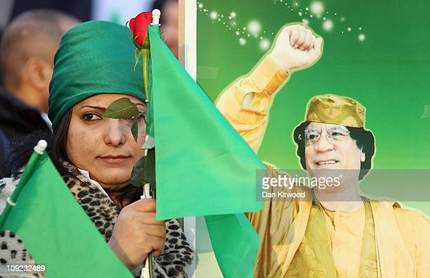 Supporters of Libyan leader Col Muammar Gaddafi gather in Hyde Park on February 17 2011 in London England Libya has faced a nationwide 'Day of Anger'...