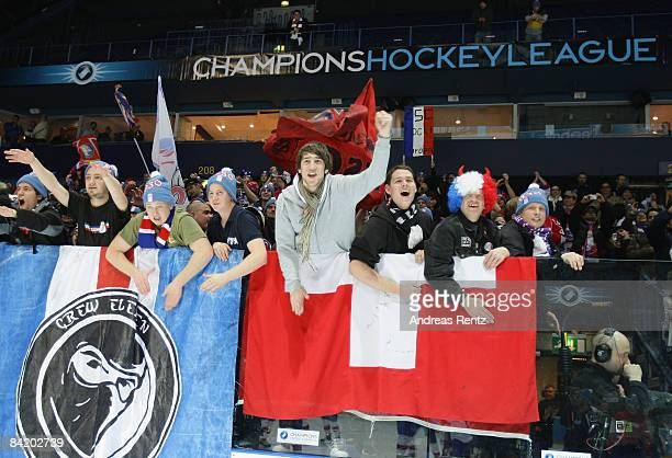 Supporters of Lions Zurich celebrate after the IIHF Champions Hockey League semi-final match between Espoo Blues and ZSC Lions Zurich at Lansi Auto...