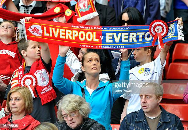 Supporters of Liverpool and Everton along with the family and friends of the 96 people who lost their lives at Hillsborough hold their scarves aloft...