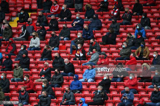 Supporters of Liverpool are seen socially distanced during the Premier League match between Liverpool and Crystal Palace at Anfield on May 23, 2021...