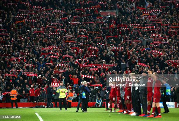Supporters of Liverpool celebrate as the players of Liverpool thank their fans after the UEFA Champions League Semi Final second leg match between...