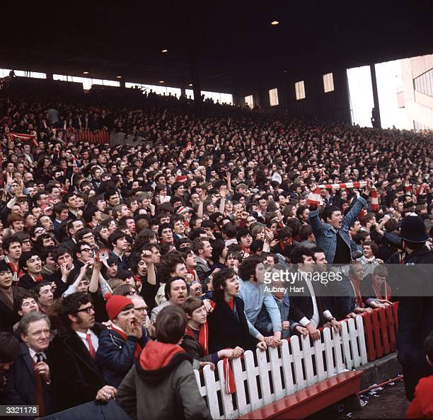 Supporters of Liverpool FC on the terraces during a semifinal match against Everton in the FA cup