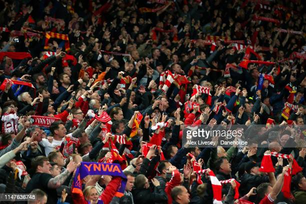 Supporters of Liverpool in The Kop celebrate after the UEFA Champions League Semi Final second leg match between Liverpool and Barcelona at Anfield...