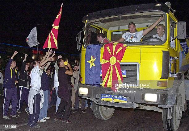 Supporters of Macedonian opposition party 'Together for Macedonia' celebrate victory September 15 2002 in Skopje Macedonia The election was free of...