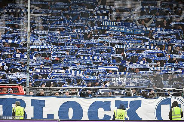 Supporters of Magdeburg cheer their team during the Third League match between between VfL Osnabrueck and Arminia Bielefeld at Osnatel Arena on...