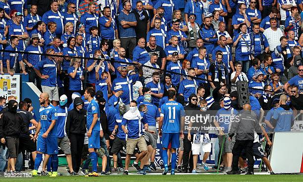 Supporters of Magdeburg enter the pitch during the DFB Cup match between 1 FC Magdeburg and Eintracht Frankfurt at MDCCArena on August 21 2016 in...