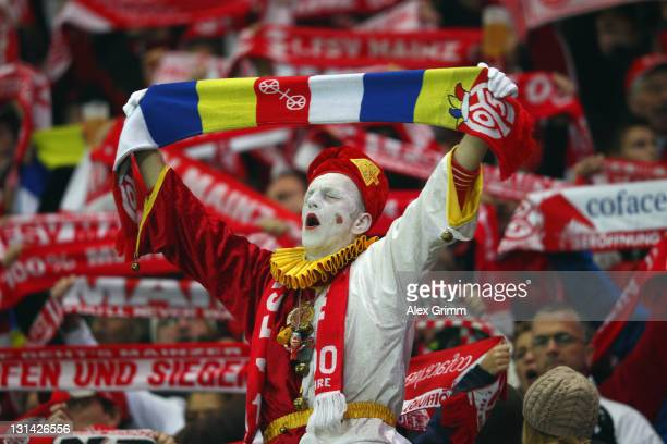 Supporters of Mainz cheer before the Bundesliga match between between FSV Mainz 05 and VfB Stuttgart at Coface Arena on November 4 2011 in Mainz...