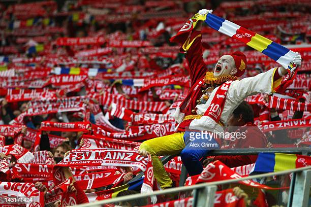 Supporters of Mainz cheer prior to the Bundesliga match between FSV Mainz 05 and VfL Wolfsburg at Coface Arena on April 20 2012 in Mainz Germany