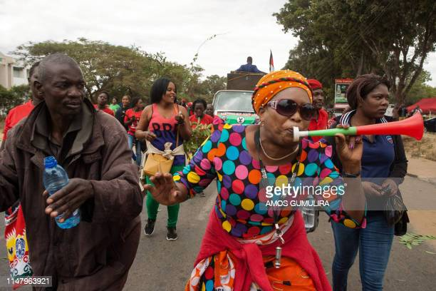 Supporters of Malawi Congress Party Leader Lazarus Chakwera shout slogans while marching from their party headquarters to Capital Hill, Government...
