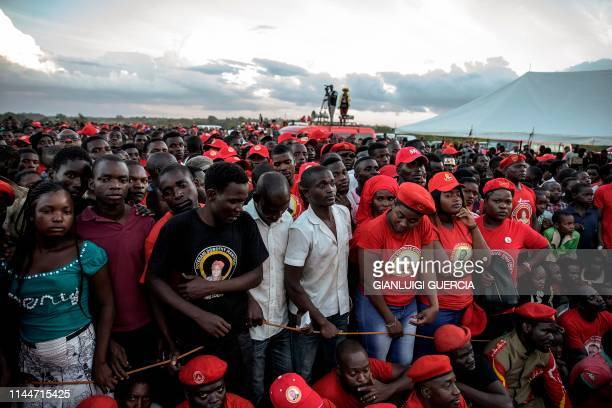 TOPSHOT Supporters of Malawian Vice President and United Transformation Movement presidential candidate Saulos Chilima listen to his address during...