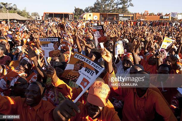 Supporters of Malawi's incumbent President cheer during her final campaign rally at Songani village on the outskirts of the city of Zomba the former...