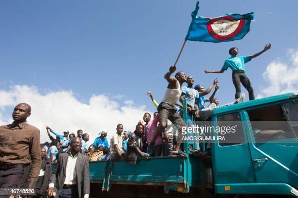 TOPSHOT Supporters of Malawi's ruling Democratic Progressive Party DPP celebrate during the swearing in ceremony of president elect Peter Mutharika...